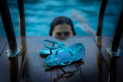 Little girl with her blue slippers (sydbad) Tags: blue girl with little sony her slippers sonya7 ilce7 sel55f18z