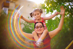 Do you know how much I love you..? (petrapetruta) Tags: flare rainbow daughter mother happy joy colorful bokeh