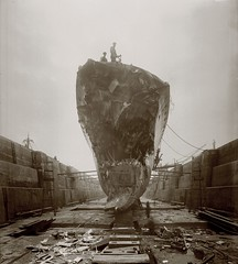 Damage suffered by HMS Broke at the Battle of Jutland (Tyne & Wear Archives & Museums) Tags: sky abstract blur men industry bar landscape interesting workers support industrial ship view panel timber mark debris grain working navy platform surreal ground vessel battle rope tools destroyer deck pile bow isleofwight porthole damage land ladder unusual mast ww1 damaged greatwar plank drydock spectator tyneside firstworldwar warship repairs fascinating digitalimage collision worldwar1 wartime eastcowes rivertyne royalnavy industrialheritage northeastengland blackandwhitephotograph navalhistory navalvessel shipbuildingheritage maritimeheritage battleofjutland extraudinary thegreatwar19141918 june1916 jsamuelwhite shiprepairing 1june1916 hmsbroke thebattleofjutland hmssparrowhawk bowdamage faulknorclassdestroyer