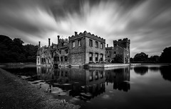 Reflections of Oxburgh (David Baterip) Tags: uk longexposure england sky blackandwhite bw reflection building castle water monochrome architecture clouds landscape hall outdoor norfolk landmark d750 moat nationaltrust oxburgh oxborough tokina1116f28 bigstopper