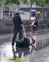 Really amused (stephenwebster2) Tags: st pancras rain wet interview reporter