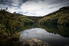 Along the Lake (the_wonderer_wanderer) Tags: nature landscape lake mountains cloudy clouds water reflection rocks naturescape french france massif pilat