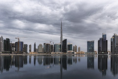 View from Business Bay (Waheed Akhtar Photography) Tags: city sky reflection water architecture clouds canon buildings dubai cityscape uae unitedarabemirates burjdubai architecturephotography businessbay canon6d burjkhalifa mydubai waheedakhtar