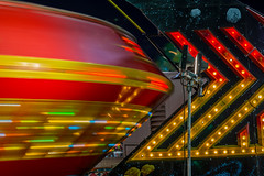 Spin me right round baby (World-viewer) Tags: park county carnival abstract motion color beautiful night lens fun 50mm prime lights amusement nice movement colorful stream nightimages ride bright artistic outdoor circus sony spin ngc fair spinning amusementpark rides f18 18 lightstream primelens a6000 ilce6000