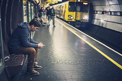 Waiting for a train (@SJA Photography) Tags: station train waiting technology tech platform smartphone mobilephone manrailway