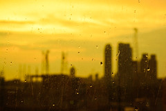 raindrops on my windowpane ([s e l v i n]) Tags: city orange india blur window rain silhouette yellow buildings evening drops cityscape monsoon bombay raindrops mumbai yellowsky selvin