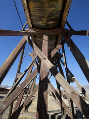 Up and Out (lefeber) Tags: california wood railroad town rust shadows perspective angles wideangle roadtrip fisheye worn depot railyard watertank ruraldecay laws farmequipment owensvalley rustymetal