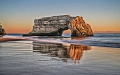 Natural Bridges (Daniel Schwabe) Tags: ocean california ca sunset usa santacruz reflection beach stone day clear naturalbridges rockbeach