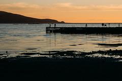 Plimmerton Beach Sunset (Ruairidh an Dorcha) Tags: sunset beach pier fishing fishermen dusk jetty wellington plimmerton porirua vsco vscofilm vision:sunset=0862 vision:clouds=0859 vision:ocean=0579 vision:sky=0954