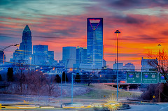 charlotte the queen city skyline at sunrise (AgFineArtPhotography.com) Tags: city morning travel blue trees winter red sky copyright usa sun cold alarm clock skyline architecture clouds buildings fire nc skyscrapers traffic charlotte thing transport first busy rush hour highrise chilly wakeup qc hdr copyrighted thequeencity atsunrise