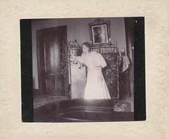 Woman in a dress hunches over in her bedroom (simpleinsomnia) Tags: old woman white black home monochrome vintage found blackwhite bedroom dress antique interior snapshot creepy ill photograph vernacular inside sick foundphotograph hunched