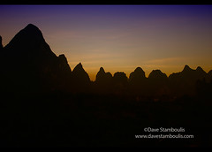 Limestone mountain scenery on the Li River at Xingping, Guangxi Autonomous Region, China (jitenshaman) Tags: china travel sunset mountain mountains nature silhouette river landscape asian liriver li scenery asia guilin yangshuo chinese peak limestone destination peaks karst guangxi xingping worldlocations