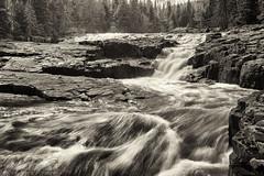 Glen Avon Falls (dtredinnick13) Tags: water monochrome minnesota blackwhite waterfall nikon rocks slow falls northshore nostalgic nik mn silky movingwater beaverbay niksilverefexpro nikon1635
