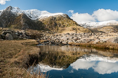 Mirror finish (Lee~Harris) Tags: uk sky cloud mountain reflection water rock wales clouds landscape outdoors nikon rocks outdoor hill snowcapped mountainside stillness rockformation d300 cwmidwal snowcappedmountain nikond300
