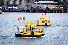 h2o taxi (kevin.boyd) Tags: ocean canada west water yellow boats coast boat bc pacific northwest harbour taxi victoria flags canadian inner checkered