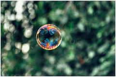colors of life in a bubble (***toile filante***) Tags: life light house macro reflection colors wonder licht colorful dof bokeh magic details dream haus bubble expressive dreamy moment emotions spiegelung leben magie soapbubble augenblick traum seifenblase wunder macromondays