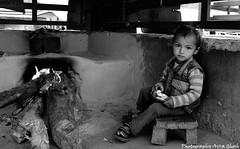 child of taluka village( har ki dun trek) (avra.ghosh) Tags: boy kitchen trekking children blackwhite child uttaranchal indianvillage harkidoon indianchildren harkidun taluka mountainboy harkiduntrek