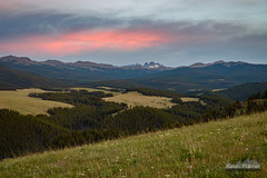 Black Tooth, Red Sky (kevin-palmer) Tags: bighornmountains wyoming july summer nikond750 tamron2470mmf28 bighornnationalforsest camping littlegoosecanyon evening sunset blacktoothmountain pasture meadow green grass orange red color colorful clouds trees forest snowcapped