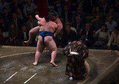 Two sumo wrestlers fighting at the ryogoku kokugikan arena, Kanto region, Tokyo, Japan (Eric Lafforgue) Tags: people male men sport japan horizontal asian japanese tokyo big fight referee asia fighter power martial wrestling fat traditional champion culture traditions lifestyle competition clash ring east indoors tournament ritual leisure sumo inside strength fullframe athlete adults wrestlers adultsonly cultural obese overweight ryogoku 3people competitors kantoregion threepeople colourpicture 2029years japan161084