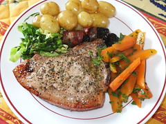 Pork chop with pancetta-wrapped prunes, cabbage, carrots and new potatoes (La belle dame sans souci) Tags: potatoes pork cabbage carrots pancetta prunes porkchops