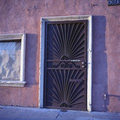 Sunset on storefront, Inglewood (ADMurr) Tags: blue sun 6x6 film rollei la purple kodak grille portra stucco inglewood