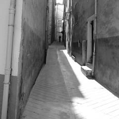 Walking away (Anne sterby) Tags: street door shadow blackandwhite white black france architecture alpes canon walking doors shadows village walk away powershot sort frankrig vej arkitektur dr skygge gr entrevaux g dre sorthvid skygger landsby s95 alperne wk