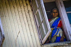 Woman looking out of window - Kerala, India - travel photography (AwYeahPhoto) Tags: poverty trip travel portrait people woman india canon nikon poor photojournalism documentary adventure backpacking travelphotography indianwoman nikond7000