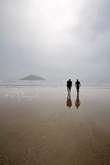 Misty Island (Katelyn's Photostream) Tags: ocean vacation mist reflection men beach misty fog walking island sand britishcolumbia foggy pacificocean longbeach tofino sandybeach 1020sigma canon7d katelynrae