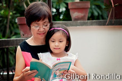 Belen & Gabby (Gilbert Rondilla) Tags: old city urban woman home senior girl smile smiling female happy reading book healthy grandmother vibrant philippines capital praying daughter happiness grand national elderly bible filipino pinay filipina jolly joyful region citizen oldage pinoy prayerful gilbertrondilla gilbertrondillaphotography