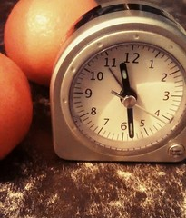 Oranges And A Clock