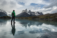 Cuernos del Paine with man walking over water (Joel Santos - Photography) Tags: chile patagonia mountain man reflection expedition water del america trekking walk joel south over glacier santos reflexion cuernos torres paine trekker