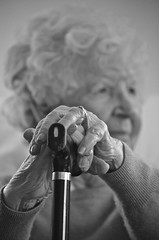 Nan at 90 (charlottz - Charlotte G Photography) Tags: old portrait bw face closeup blackwhite hands nikon naturallight monotone walkingstick elderly nan 90 projectflickr d5100