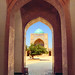BUKHARA, UZBEKISTAN - JULY 08: Beautiful view of ancient Poi Kalyan Mosque through a traditional islamic arch portal on July 08, 2014 in Historic Center of Bukhara, Uzbekistan, Central Asia