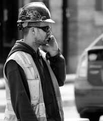 Local 135 (Neil. Moralee) Tags: street boy portrait blackandwhite bw sunlight white canada man black monochrome face hat mobile work mono glasses hoodie construction nikon zoom outdoor montreal candid telephone union helmet hard neil canadian safety hart worker local member talking fone protection unshaven buder hiviz 18300mm takl d7100 morlee local135