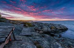 Pink sky (ordjuret) Tags: ocean sunset sky sun water stone clouds rocks gothenburg cliffs archipelago hisingen