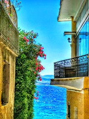 Loutraki's secret corners... (Christos Andreou) Tags: travel people walking boats spring photographer wind ngc relaxing bluesky oldbuildings serenity meditation melancholy naturalbeauty beachwalking urbanlandscape loutraki backintime bythesea corinthia beautifulworld greennature sealandscape greeksun corinthiangulf spectacularphotos secretpaths hdrfilter holidaysingreece greekcoastline theworldwelive galaxycamerasamples oldloutraki voltastoloutraki opticalzoomphotos