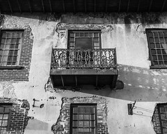 Untitled (mnmlong) Tags: old brick georgia shadows historic mortar metalwork riverfront savannah ironrailing