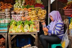woman tendering her market (Sam Scholes) Tags: market bedugul candid travel store keeper portrit shop vacation indonesia shopping bali shopstore storekeeper baturiti id