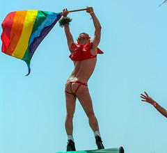 Raising the Flag on IL (TA) Jima (ybiberman) Tags: portrait man tattoo israel telaviv highheels dancing candid streetphotography prideparade stiletto rainbowflag buttocks provocative flowercrown