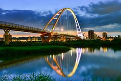 _2(DSC_8902) (nans0410(busy)) Tags: bridge light sunset reflection building river taiwan  shinjo      newtaipei