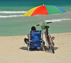 At the Beach (nebulous 1) Tags: male guy water bike umbrella sand chair nikon waves florida sunny atthebeach miamibeach nebulous1