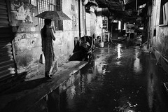 Rainy night (Huang Qing) Tags: china street blackandwhite bw night umbrella dark alley candid 28mm streetphotography stranger snap rainy gr ricoh