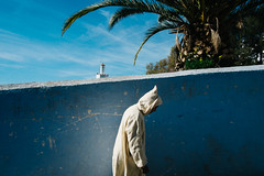 Chefchaouen, Morocco 2015 (f.d. walker) Tags: africa street travel blue shadow sky sun sunlight white mountains color tower church colors wall clouds contrast walking candid colorphotography streetphotography streetportrait bluesky clothes morocco berber chefchaouen bluecity candidphotography travelphotography