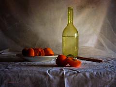 Still Life & Apricots (MargoLuc) Tags: lighting summer stilllife food orange white green classic texture window june fruit table bottle soft shadows dish time sweet seasonal knife pottery apricots albicocche skeletalmess