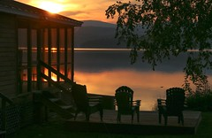 Would You Not Like To Be....? (SueZinVT) Tags: sunrise lakebomoseen porch silhouettes davematthews canon70d adirondackchairs water clouds sun sky trees lawn beachhouse