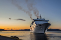 Departure..... (Siggi007) Tags: ship tourism tourists tourist travel reisen cruise cruiseship boat sunset sky sea ocean water blur smoke silhouette silhouettes colors colores canoneos6d seaside seascape norway norwegen bergen beautiful ts serene environment magellan harbor europa evening outdoor orange ocanos photo picture panorama awesome abend scandinavia scenery dof depthoffield flickr foto farben farbe fjord focus fjords himmel light outstanding canon colour contrasts view vieux vessel vacation bilde norge mood holiday vacaciones ferien barco schiff lapuestadelsol ocaso tamron golden