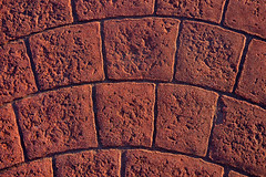background with textured cobbles on walkway (Mikel Martnez de Osaba) Tags: road street pink red urban abstract brick texture rock stone way tile square pattern floor outdoor pavement path walk background ground surface cobble sidewalk walkway granite paving material block rough footpath textured paved tiled