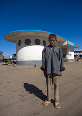 Boy Standing In Front Of A Service Station By Carlo Marchi And Carlo Montalbetti, Asmara, Eritrea (Eric Lafforgue) Tags: africa sky people men childhood vertical retail architecture outdoors photography day child gasstation transportation service oneperson clearsky obsolete rundown onepeople asmara eritrea hornofafrica fuelpump realpeople colorimage lookingatcamera eritreo buildingexterior onemanonly erytrea childrenonly eritreia colourimage africanethnicity 1people إريتريا ertra 厄利垂亞 厄利垂亚 エリトリア eritre eritreja eritréia fuelandpowergeneration builtstructure эритрея érythrée africaorientaleitaliana ερυθραία 厄立特里亞 厄立特里亚 에리트레아 eritreë eritrėja еритреја eritreya еритрея erythraía erytreja эрытрэя اريتره אריתריה เอริเทรีย eri5119