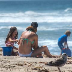 Mom, Daughter, and a Blue Bucket (Kevin MG) Tags: ocean ca girls usa cute beach water kids children mom fun bucket sand young malibu zuma bikinis boogieboard preteen zumabeach tonemapped