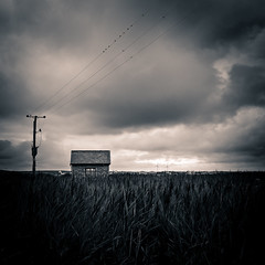 Energy (N_Davies. http://www.calvendo.co.uk/galerie/autor/) Tags: sky blackandwhite storm building field wales square landscape outdoors energy power cloudy dramatic powerlines electricity marsh picturesque atmospheric caernarfon dinasdinlle sel35f18